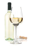 White wine glasses, bottle and corkscrew Stock Image