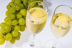 White wine glasses and fresh grape Royalty Free Stock Images