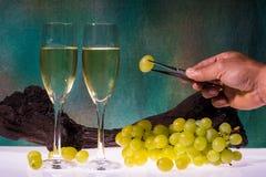 White wine glasses and fresh grape Stock Photos