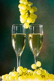 White wine glasses and fresh grape Stock Images