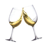 White wine glasses. Toasting of two white wine clear glasses Stock Photo