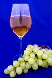White wine with grape. White wine with green grape Stock Photos