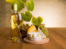 White wine with grape and cheese snack royalty free stock image