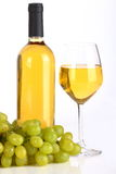 White wine and grape. Glass of white wine with bottle and grapes on white background Stock Image