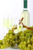 White wine and grape. Glasses of white wine with bottle and grapes on white background Royalty Free Stock Photo