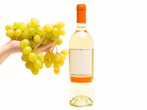 White wine with grape in hand Stock Images
