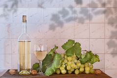 White wine, grape on old wood. Bottle wine, glass wine on wood Stock Photo