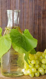 White wine with grapes Stock Photos