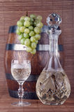 White wine with grapes. Bottle and glass of white wine with grapes Stock Photography