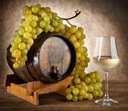 White wine with grapes and barrel Stock Photos