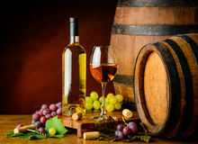 White wine and grapes with barrel Stock Images