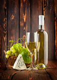 White wine with grapes and blue cheese Stock Photography