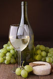 White wine, grapes and cheese Royalty Free Stock Photography