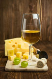 White wine with grapes and cheese Stock Photography