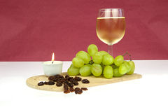White wine grapes and raisins with candle Royalty Free Stock Photography