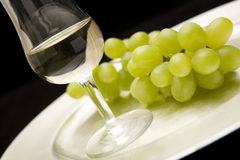 White wine and grapes on tray Royalty Free Stock Image