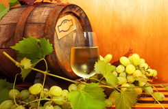 White wine with grapes and a wine barrel Stock Photo