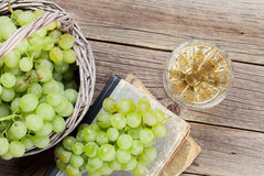 White wine and grapes. On wooden table. Top view Stock Photo