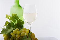 White wine green bottle glass and grape Royalty Free Stock Image