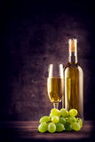 White wine with green grapes Stock Photos