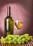White wine and green grapes Royalty Free Stock Photo