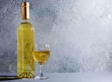 Free White Wine In Glass Wine Glasses, A Bottle Of Wine. Blue Background. Copy Space Royalty Free Stock Photos - 156409348