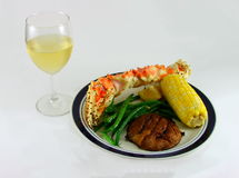 White Wine and King Crab Leg Royalty Free Stock Images