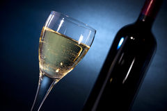 Free White Wine On A Glass Closeup & A Bottle Royalty Free Stock Images - 18401929