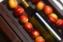 White wine and peaches Royalty Free Stock Images