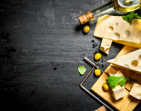 White wine with pieces of flavored cheese and olives. Stock Photo