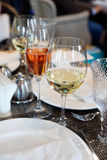 White wine and pink champagne on table Royalty Free Stock Photo