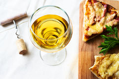 White wine and pizza Stock Images