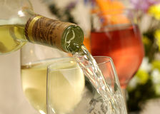 White wine pour Stock Photography