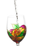 White wine poured in a stained glass Royalty Free Stock Images