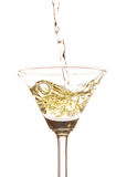 White wine poured in a wine glass Royalty Free Stock Images