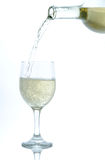 White wine pouring. White wine being poured into a glass Royalty Free Stock Photo