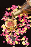 White wine pouring down from a bottle royalty free stock image