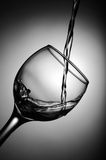 White wine pouring into glass Royalty Free Stock Photography