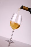 White wine pouring Royalty Free Stock Image