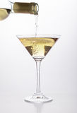 White wine pouring in a glass Stock Photography