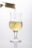 White wine pouring in a glass Stock Photos
