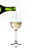 White wine pouring Stock Image