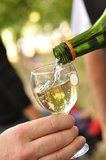 White wine pouring into glass Royalty Free Stock Image