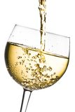 White wine pouring into glass tilted with space for text Royalty Free Stock Photo
