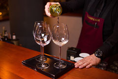 White wine is pours. An white wine is in beautiful glass, in restaurant is pours Royalty Free Stock Photography
