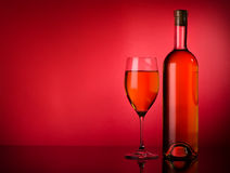White wine on a red background Royalty Free Stock Photo