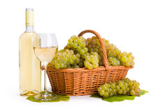 White wine and ripe white grape in basket royalty free stock images