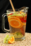 White Wine Sangria. Pitcher of white sangria and fruit with wooden spoon Stock Images