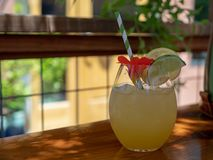 White wine sangria cocktail drink sitting on table at a tropical royalty free stock image