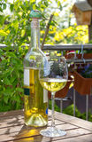 White wine served in garden Royalty Free Stock Photo